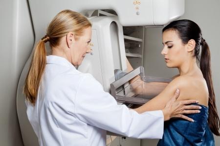 Doctor Performing Mammogram on Patient